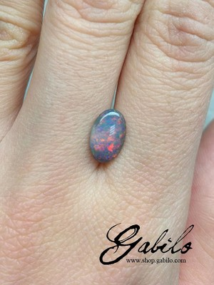 Black opal oval cut 0.94 ct