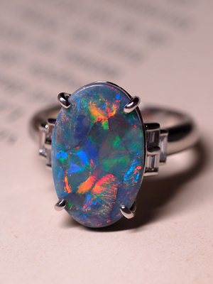 Platinum black opal and diamond ring