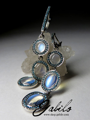Moonstone gold earrings with blue diamonds