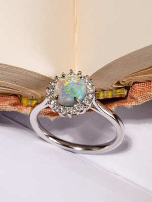 Opal gold ring with diamonds