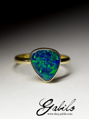 Gold ring with black opal doublet